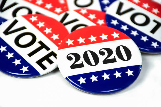 election voting pins for 2020 close up of political voting pins for 2020 election on white modern period stock pictures, royalty-free photos & images