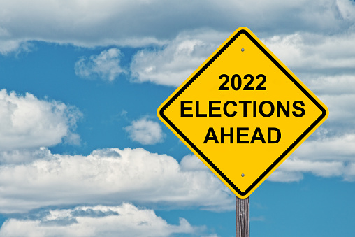 2022 Election Ahead - Caution Sign Blue Sky Background -