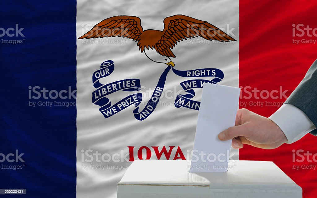 elections voting in front of flag of iowa stock photo