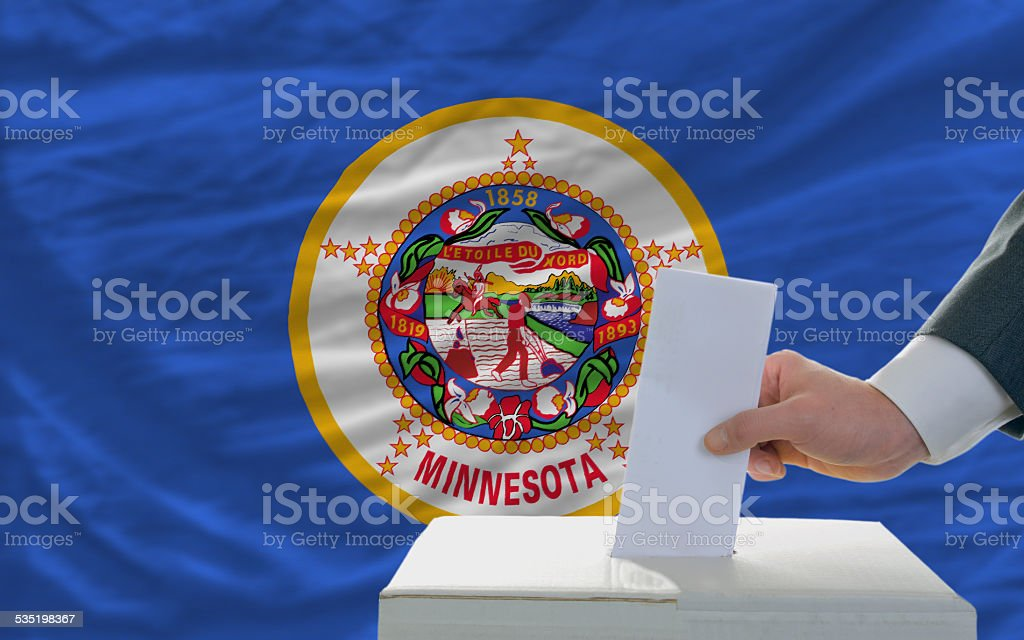 elections voting in front of flag of minnesota stock photo