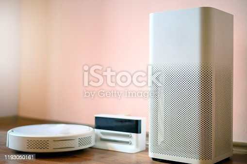 177118473 istock photo Electric air purifier and robot vacuum cleaner 1193050161