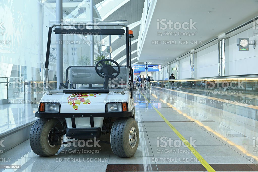Electric сar services and tourists in the airport royalty-free stock photo