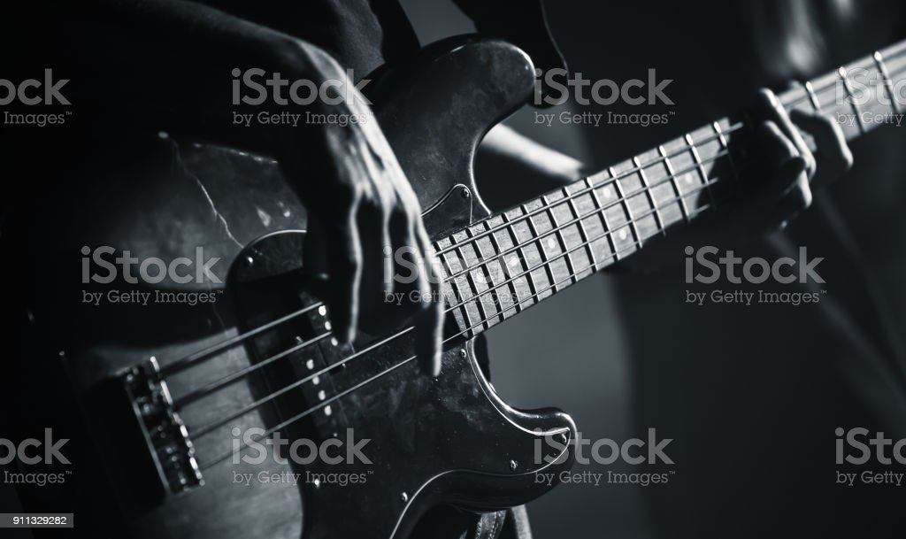 Electric bass guitar black and white photo stock photo