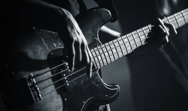electric bass guitar black and white photo - rock music stock pictures, royalty-free photos & images