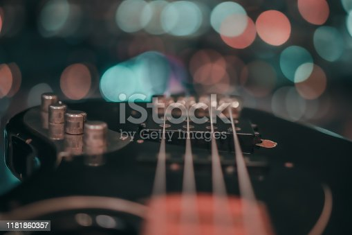 istock Electric bass guitar blurred background 1181860357