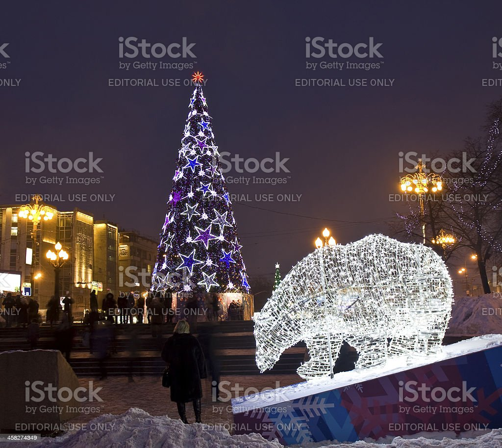 Electric bear and Christmas tree royalty-free stock photo