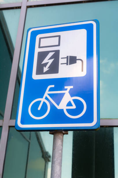 electric bicycle charging point sign stock photo