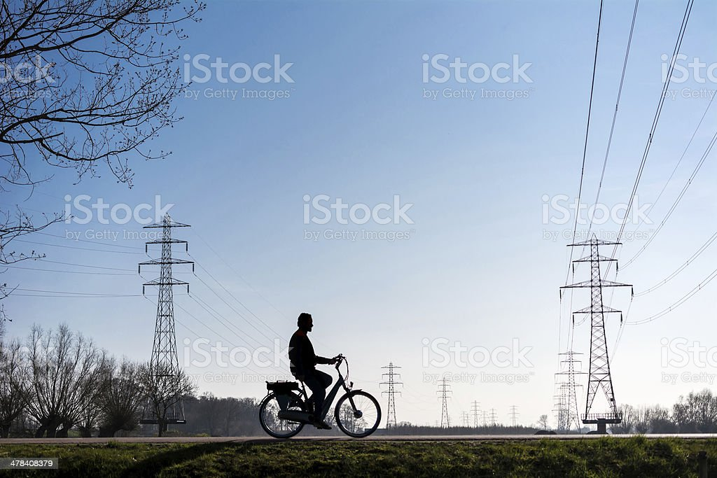 Electric bicycle silhouette stock photo