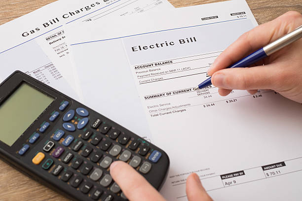 Electric bill charges paper form on the table - Photo