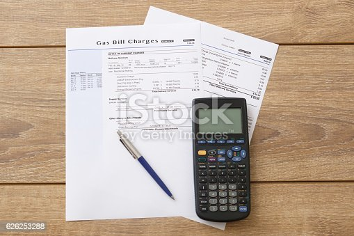 istock Electric bill charges paper form on the table 626253288