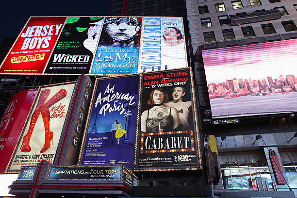 electric billboards in times square new york advertising theatre - mamma mia stock photos and pictures