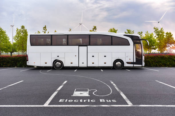 Electric bus on charging stock photo
