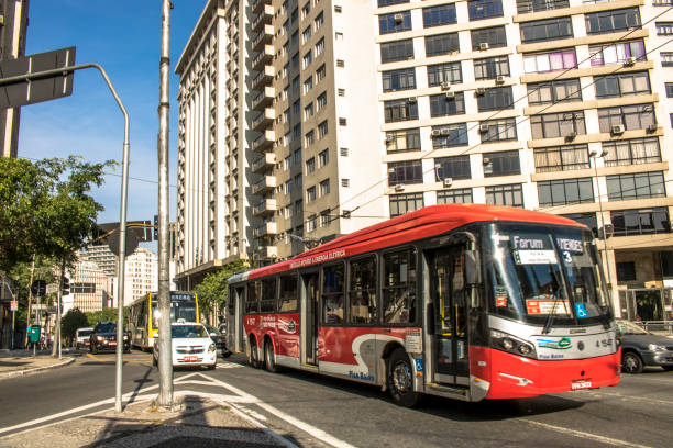 Electric bus travels stock photo