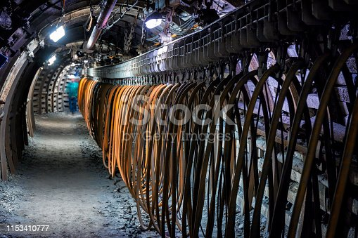 Hard coal mine underground corridor with steel support system and electrical equipment, Makoszowy coal mine in Zabrze, Poland