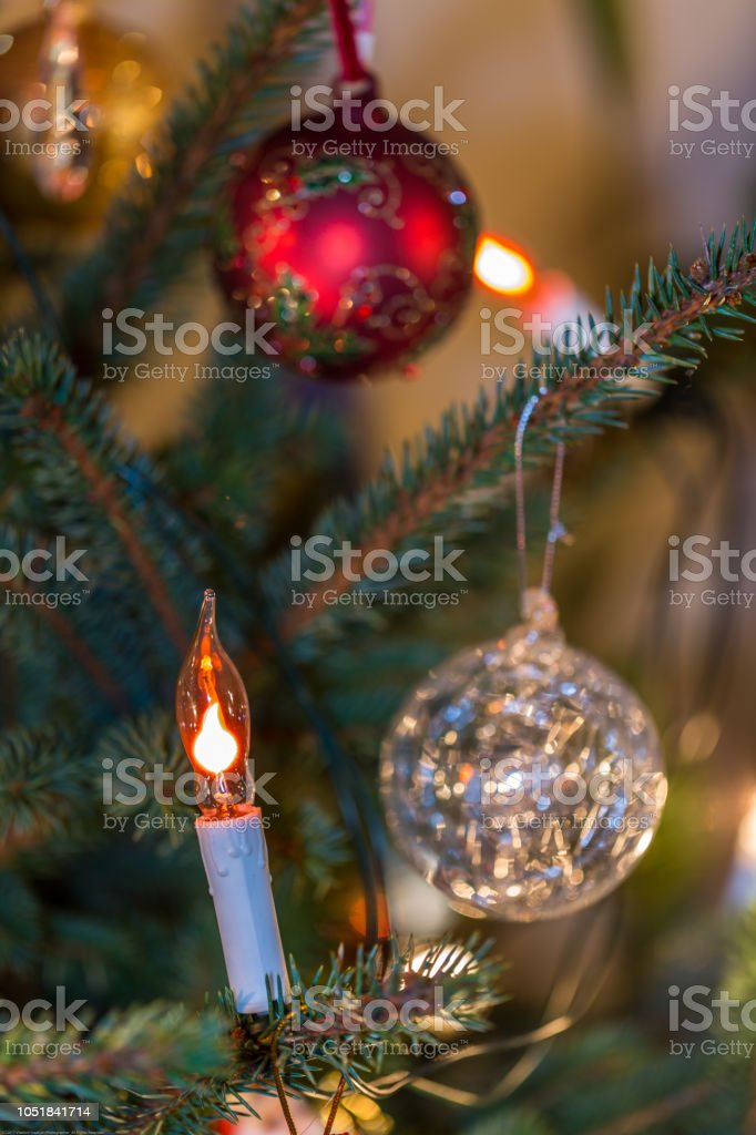 Electric Candle And Decorations On Christmas Tree Stock Photo More