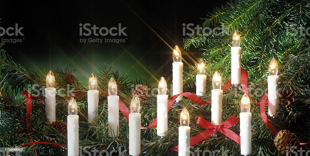 electric candles in Christmas tree stock photo
