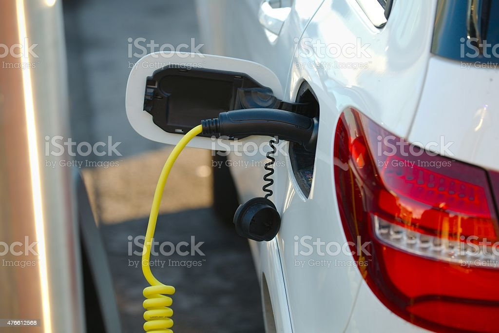 Electric car charger stock photo