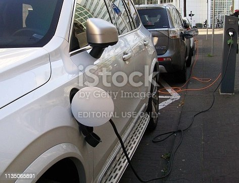 istock Electric Car Charging At Electric Vehicle Recharge Station Scene 1135065891