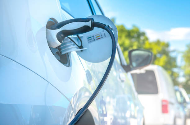 Electric Car Charging At Power Station stock photo