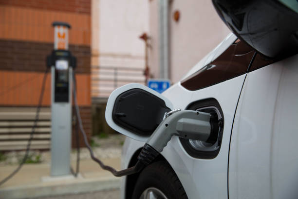 Electric Car Charging At Public Station - foto stock