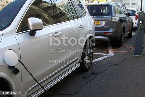 istock Electric Car Charging At Recharge Station Scenery During The Day 1135065707