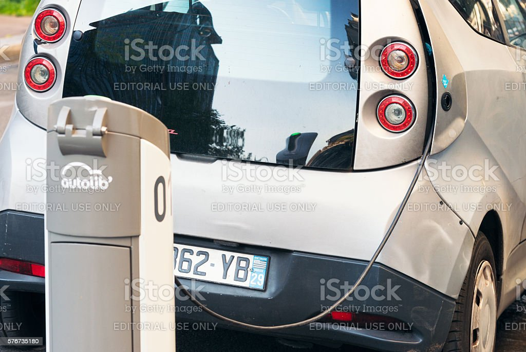 Electric Car charging on a Paris Street stock photo