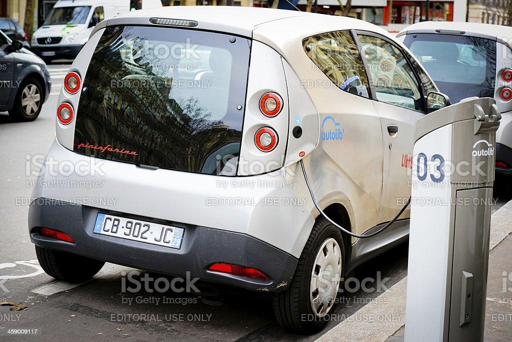 Electric Car Charging on Paris Street stock photo
