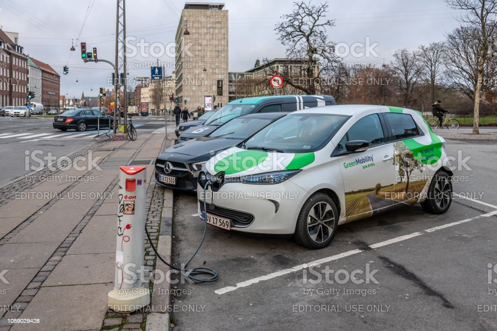 Electric car charging on the road in Copenhagen stock photo