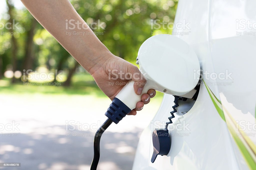 Electric car charging stock photo