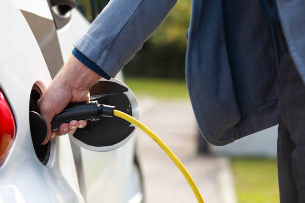 electric car charging - macchina ibrida foto e immagini stock