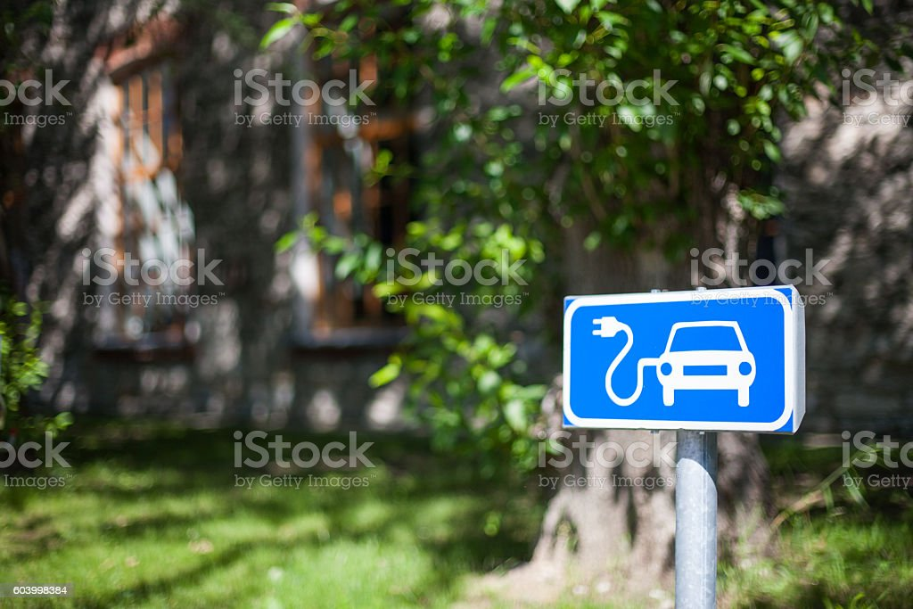 Electric car charging spot traffic sign in blue and white stock photo