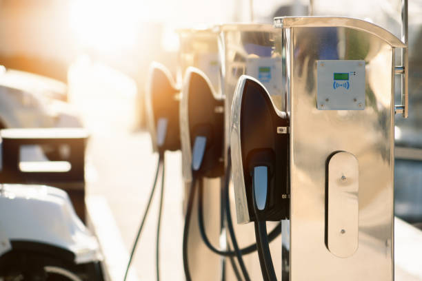 Electric car charging station Electric car charging station in luxury marina by the sea electric vehicle charging station stock pictures, royalty-free photos & images