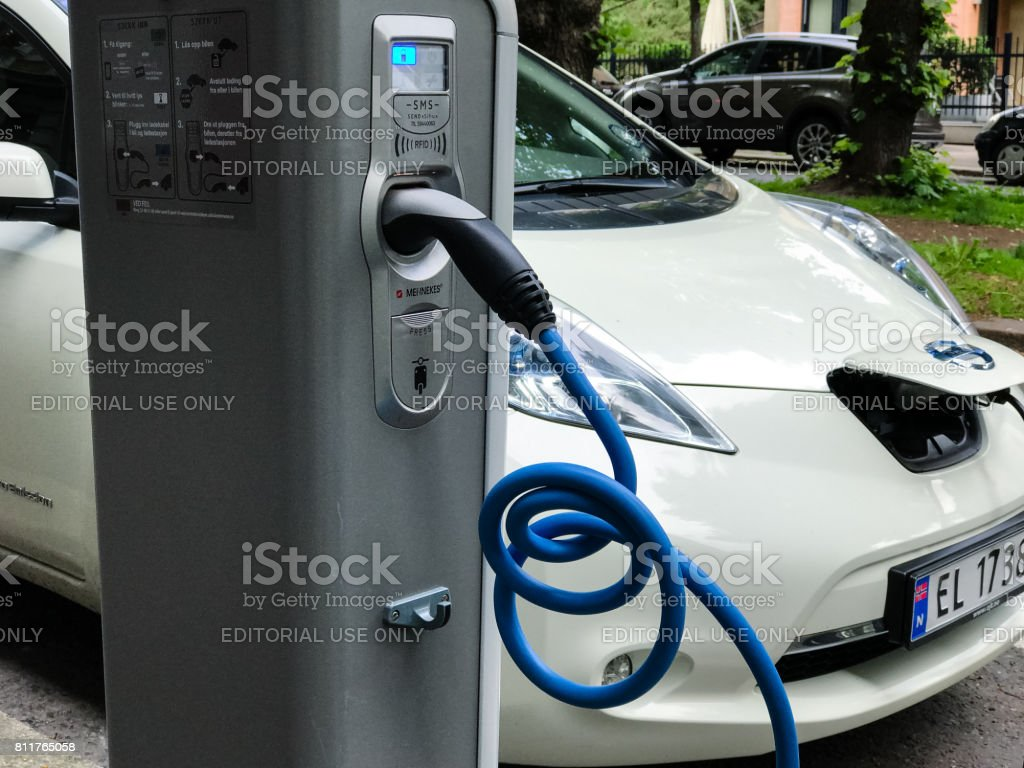 Electric car charging station. Eco automobile that sparked a...