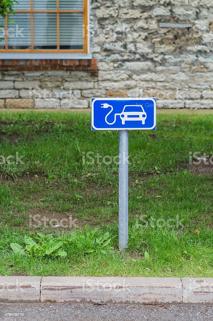 Electric car charging station sign stock photo