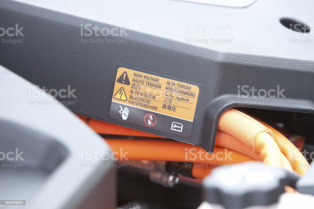 Electric Car Engine Compartment with High Voltage Sticker stock photo
