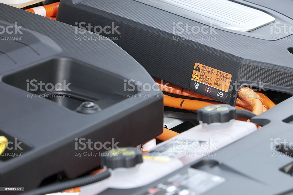Electric Car Engine Compartment with High Voltage Sticker royalty-free stock photo