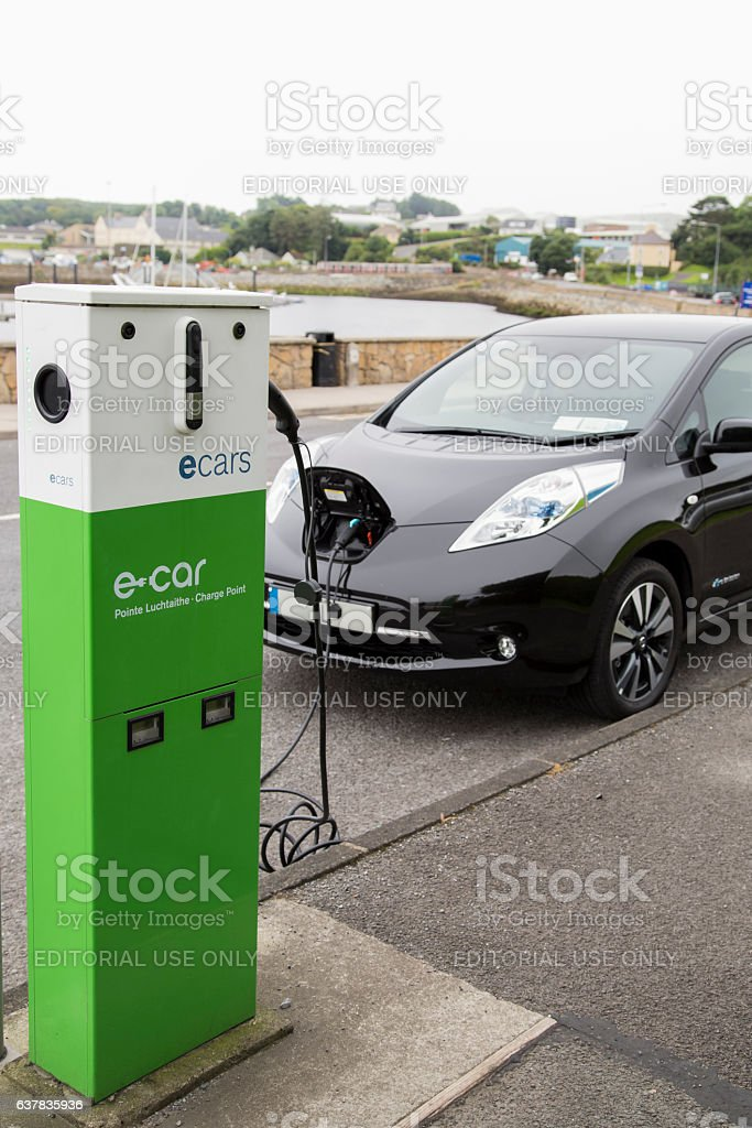 Electric car in charging. stock photo