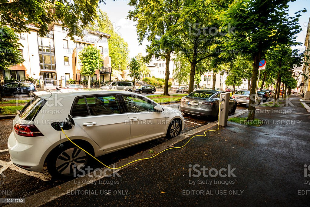 Electric car  is charging on Oslo street, Norway stock photo