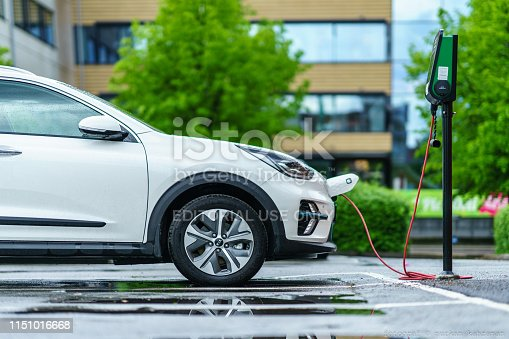 Gothenburg, Sweden - May 21th, 2019 :KIA NIRO electric car is charging on street parking lot of Lindholmen, Gothenburg