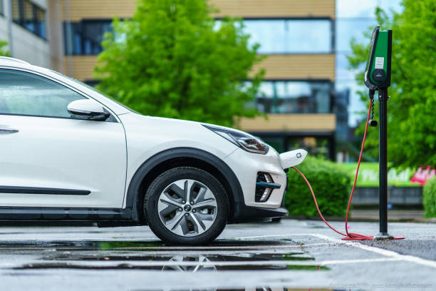 KIA NIRO electric car is charging on street parking lot Gothenburg, Sweden - May 21th, 2019 :KIA NIRO electric car is charging on street parking lot of Lindholmen, Gothenburg vehicle brand name stock pictures, royalty-free photos & images