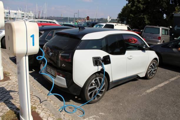 electric car parked and charging - resultados lisboa imagens e fotografias de stock