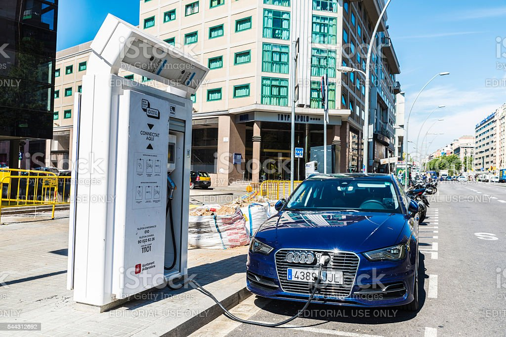 Electric car recharging battery, Barcelona stock photo