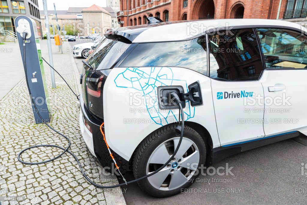 Electric car recharging the batteries in Berlin, Germany stock photo