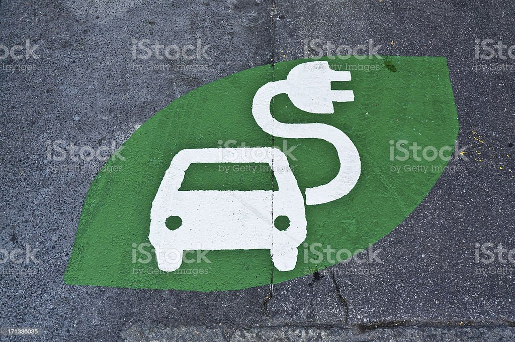 Electric car sign, charging station, green sign painted on street stock photo