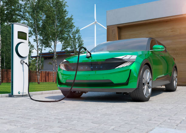 electric car suv charging at home in front of modern low energy suburban house - macchina ibrida foto e immagini stock