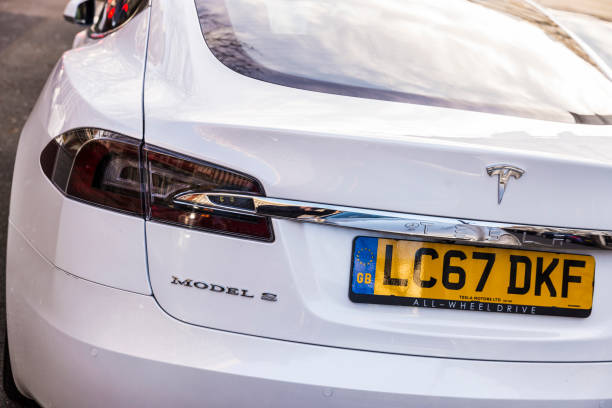 Electric car Tesla Model S in London, Great Britain London, Great Britain  - January 3, 2018: White electric car Tesla Model S parked on a street in London, Great Britain tesla model s stock pictures, royalty-free photos & images