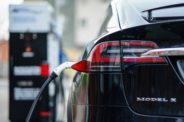 Electric Car Tesla Model X is charging on street charge station in UK. Coventry, UK - November 25th, 2018 : Electric Car Tesla Model X is charging on street charge station in UK. tesla motors stock pictures, royalty-free photos & images