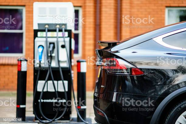 Electric Car Tesla Model X Is Charging On Street Charge Station In Uk Stock Photo - Download Image Now