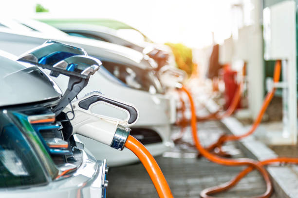 Electric cars are charging in station stock photo