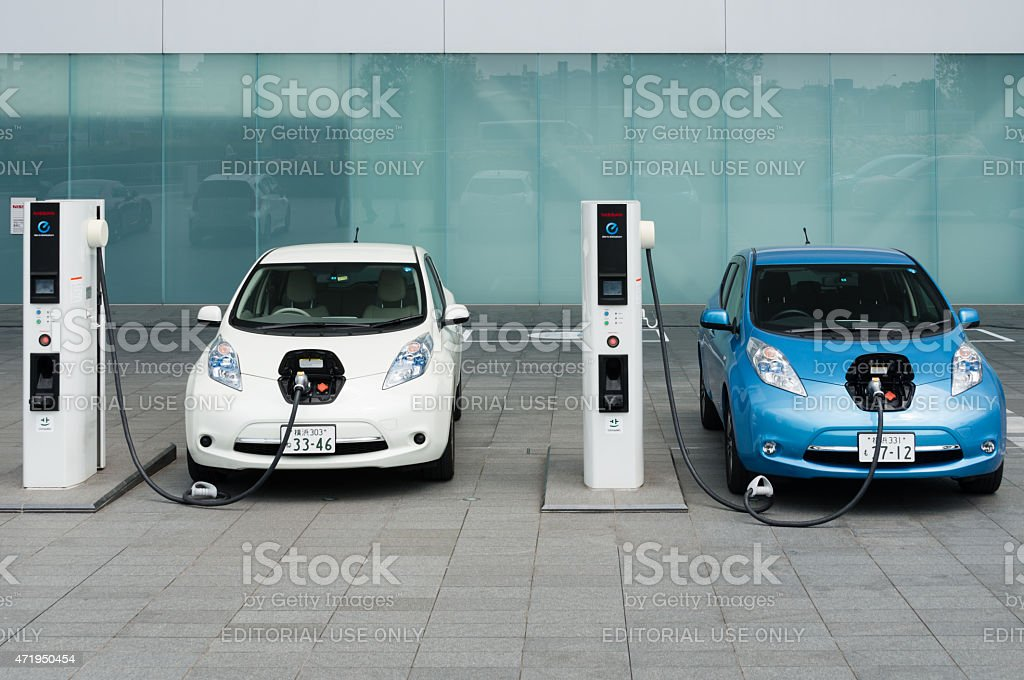 Electric Cars Being Charged At Charging Stations Stock Photo More